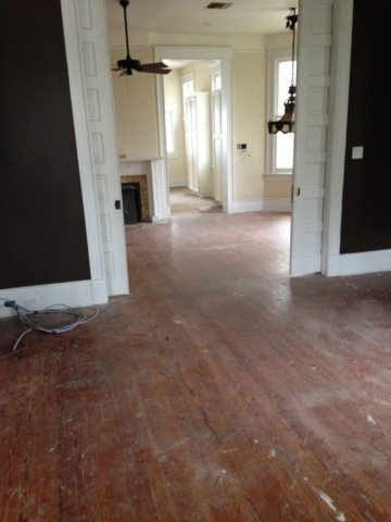 Hardwood floors in living areas prior to being refinished.